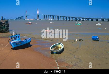 Loire, river, mouth, coast, low tide, boats, bridge, Pont de Saint Nazaire, St. Nazaire, Department Loire-Atlantique, - Stock Photo