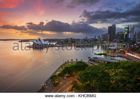 Dramatic Sunrise Over Sydney Opera House and The Rocks, Sydney, New South Wales (NSW), Australia - Stock Photo