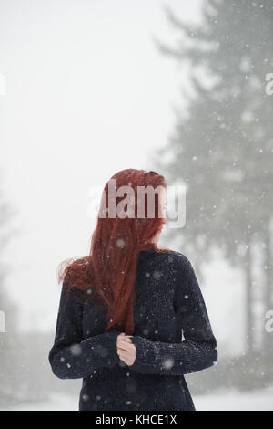 Girl behind hat - Stock Photo
