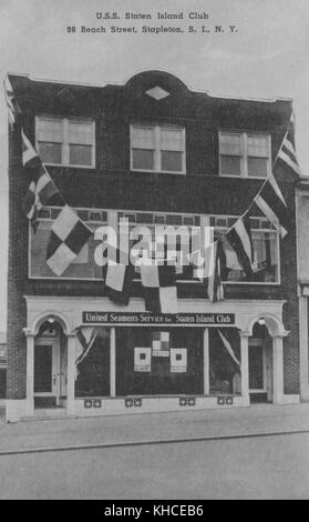 A postcard from a photograph of a local branch of the United Seamen's Service, the three story brick fronted building - Stock Photo