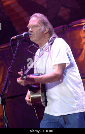 Neil Young performing during Farm Aid 2007 at Randall's Island in New York City on September 9, 2007. Credit: David - Stock Photo