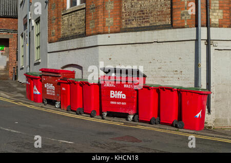 A line of red waste and recycling bins, town centre, Northampton, UK - Stock Photo