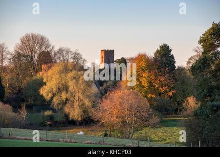 Autumn sunrise across the village of Tadmarton with Saint Nicholas church tower in the distance. Tadmarton, Oxfordshire, - Stock Photo