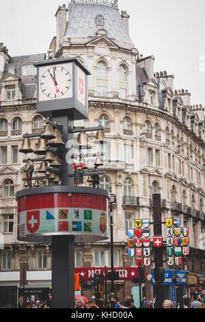 Swiss Glockenspiel (chime) clock in Leicester Square. London, 2017. Portrait format.
