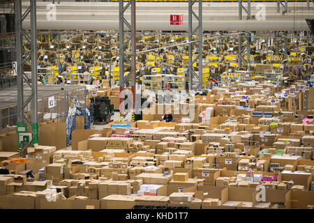 Staff at the Amazon fulfilment centre in Peterborough,Cambridgeshire,on Wednesday November 15th preparing for Black - Stock Photo