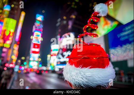 Santa hat with colorful Christmas lights in Times Square, New York City - Stock Photo