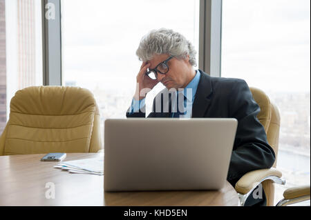 Mature business man works with docs - Stock Photo