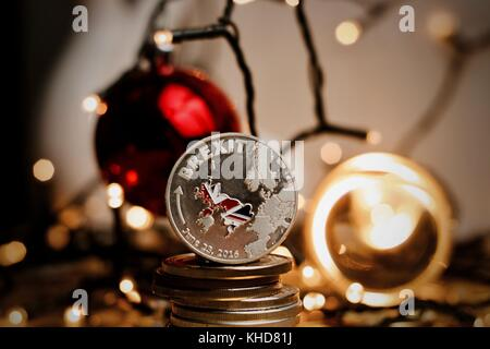 Physical brexit silver coin with british map. Europe leaving. Article 50. Christmas concept. - Stock Photo