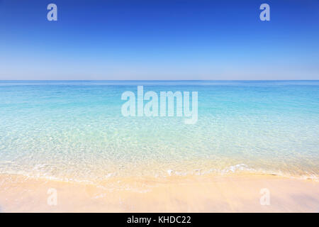 Dubai beach on a sunny day. Dubai tropical resort background. Nobody on tropical beach. Empty Persian Gulf seashore - Stock Photo