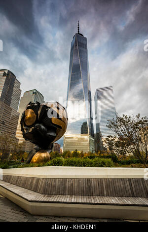 The Sphere in Liberty Park and Freedom tower on the back in New york City - Stock Photo