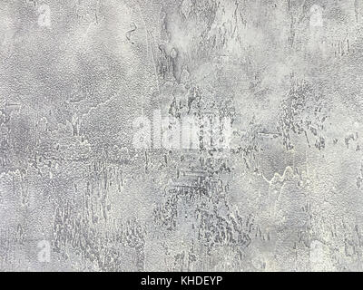 Old gray wall covered with shabby uneven plaster. Texture of vintage silver stone surface, closeup. - Stock Photo