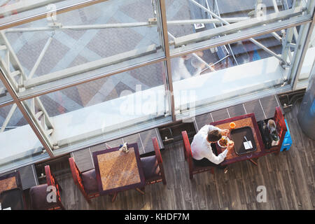 business lunch, top view of businessman eating in cafe, high angle of canteen for employees - Stock Photo