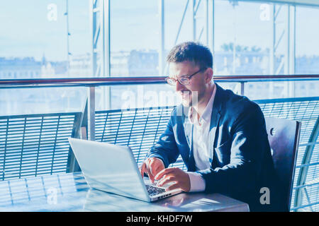 business man entrepreneur working on computer, businessman reading emails and smiling - Stock Photo
