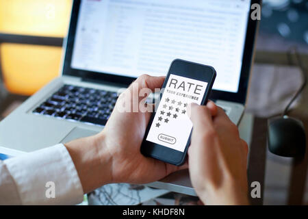 rating feedback concept, review on the screen of mobile phone - Stock Photo