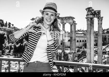 Roman Holiday. happy elegant woman near Roman Forum in Rome, Italy showing heart shaped hands - Stock Photo