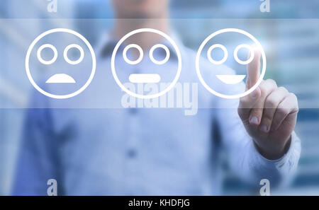 customer satisfaction concept, touchscreen survey with smileys - Stock Photo