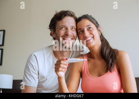 Couple pleased with pregnancy test results - Stock Photo