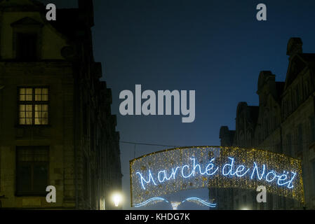Illuminated sign advertising an outdoor Christmas market in French - Stock Photo
