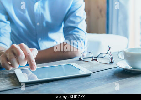 man using digital tablet computer, close up of the hand, business and technology background with copy space - Stock Photo
