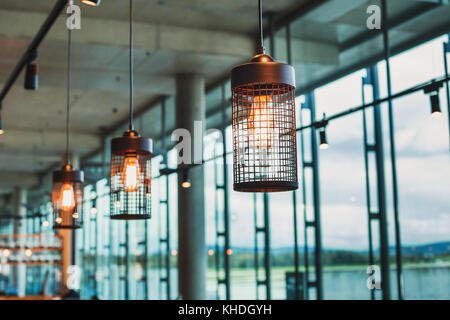 hanging lamps in abstract modern interior of cafe or restaurant, scandinavian design - Stock Photo