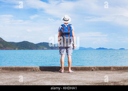 tourist traveler with backpack ready for new travel adventure, background with copy space - Stock Photo