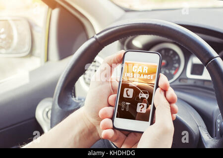 car insurance concept, driver reading website on smartphone - Stock Photo
