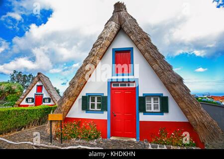 Traditional palheiros - straw-roofed houses of Santana, Madeira, Portugal - Stock Photo