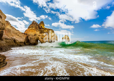 Waves crashing on the rocks at Praia Dos Tres Irmaos near Portimao, in Algarve region, Portugal - Stock Photo