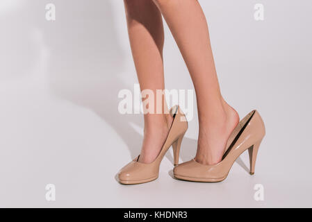 girl in oversized high heeled shoes - Stock Photo