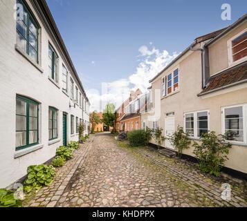 Narrow residential street in the medieval town center of Helsingor / Helsingør, Denmark, Scandinavia. - Stock Photo