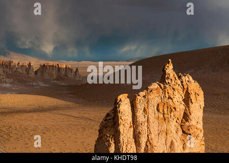 Sunet and storm coming at the amazing Cathedrales at Salar de Tara in the Chilean Atacama desert - Stock Photo