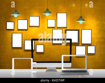 Workspace of computer set and Vintage photo frame wall background and light, Interior gallery design and workplace - Stock Photo