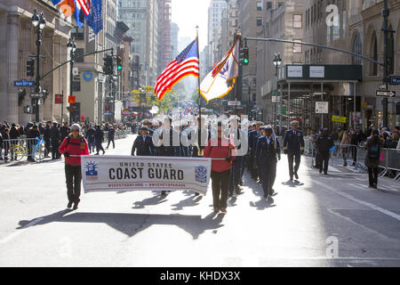 Members of the United States Coast Guard Vets Association march up 5th Avenue in the Veterans Day Parade in New - Stock Photo
