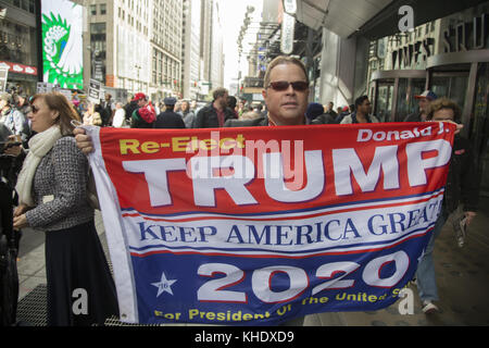 Trump supporter outside a large anti Trump/Pence regime rally in Times Square in New York City. - Stock Photo