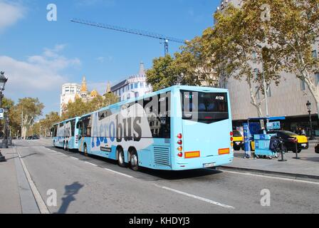 Aerobus airport shuttle buses parked at their stop in the Placa de Cataluyna in Barcelona, Spain on November 1, - Stock Photo