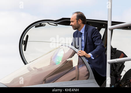 PARIS, FRANCE - JUN 23, 2017: French Prime Minister Edouard Philippe getting out of Dassault Rafale fighter jet - Stock Photo