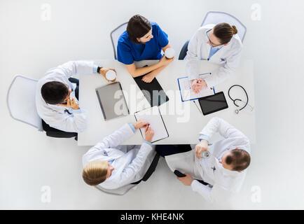 group of doctors having coffee break at hospital - Stock Photo