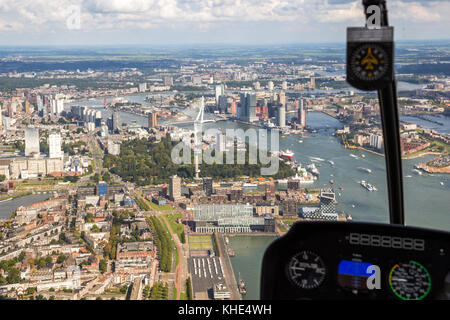 ROTTERDAM, THE NETHERLANDS - SEP 2, 2017: Aerial helicopter view on the Erasmus bridge and downtown Rotterdam city. - Stock Photo