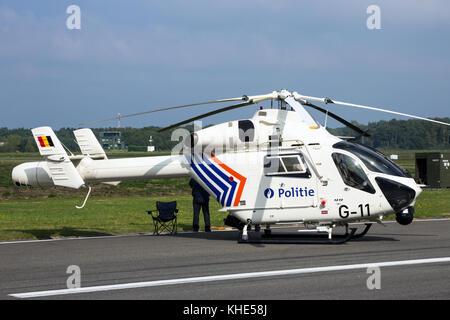 KLEINE BROGEL, BELGIUM - SEP 13, 2014: Belgian Police McDonnell-Douglas MD900 Explorer helicopter on the tarmac - Stock Photo