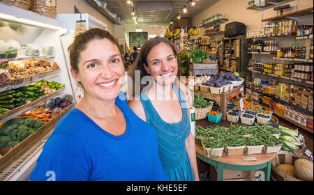 From left, Each Peach Market Co-owners Jeanelouise Conaway and Emily Freidberg take time to talk about why they - Stock Photo