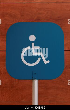 Blue disabled sign - Stock Photo