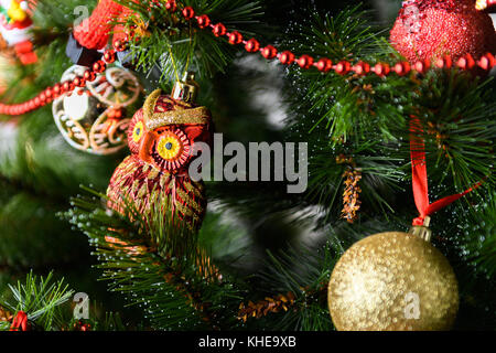 Decorated Christmas tree on blurred, sparkling and fairy background - Stock Photo