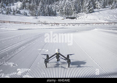 DJI Inspire 1 Drone powered on and ready to take flight in the snowy mountains of Bulgaria - Stock Photo