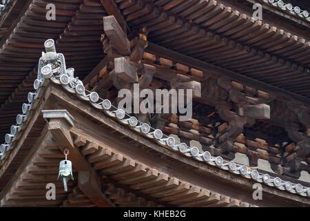 Nara, Japan - May 30, 2017:  Wooden roof construction of the Five Storied Pagoda of the Kofukuji Temple in Nara - Stock Photo