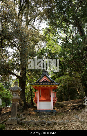 Nara - Japan, May 31, 2017: Shinto shrine in the the Kasugayama Primeval Forest, registered as a UNESCO World Heritage - Stock Photo
