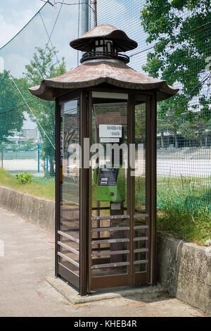 Iga Ueno - Japan, June 1, 2017: Telephone booth shaped like Bashos Haiseiden Hall in Iga Ueno park - Stock Photo