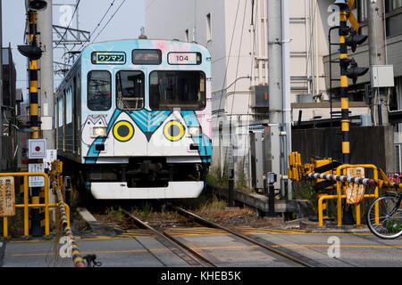 Iga Ueno - Japan, June 1, 2017: Kintetsu private railway, Iga Tetsudo, Iga Line, train  decorated with Ninja characters - Stock Photo