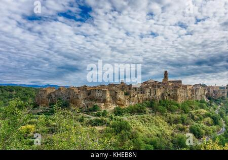 Horizontal photo of the ancient city of Pitigliano in Tuscany Italy. The town is built from tuff stone. Road which - Stock Photo