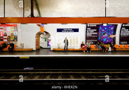 Paris, France. Paris Metro station - Palais Royal / Musee du Louvre. People on the platform - Stock Photo