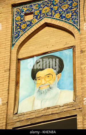 Portrait of Ayatollah Chamenei on the Ali Qapu Palace, Imam Square, Meydan-e Naqsh-e Jahan, Isfahan, Iran - Stock Photo